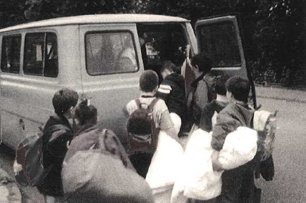 An old photo of children going on a trip